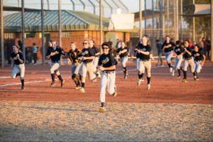 Softball players running.