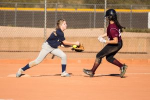 Softball player catching ball.