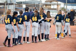 Softball players in a line.