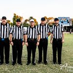 refs pose for picture