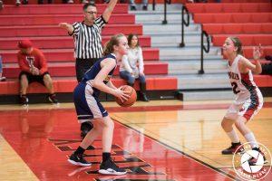 girl inbounding basketball