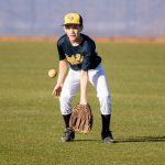 Boy fielding baseball