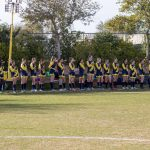 girl soccer team during national anthem