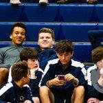 Boys sitting in bleachers before game