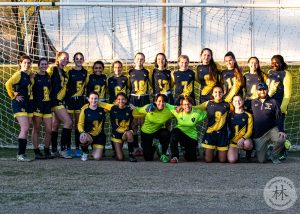 soccer girls team and coach