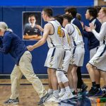 boys and coach celebrating charge foul