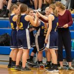 girls and coach huddle before game start
