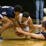 boys struggle for loose basketball