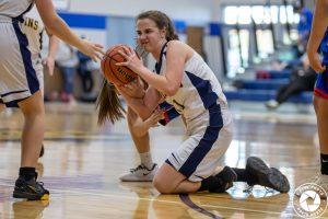 girl fighting for loose basketball