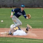 opponent running for ball as boy completes slide into second base