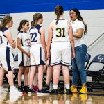 girls and coach in huddle