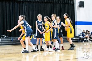 girls fight for position for inbound pass