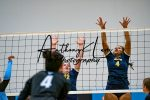 girls blocking volleyball