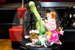 stuffed animals sit on chair