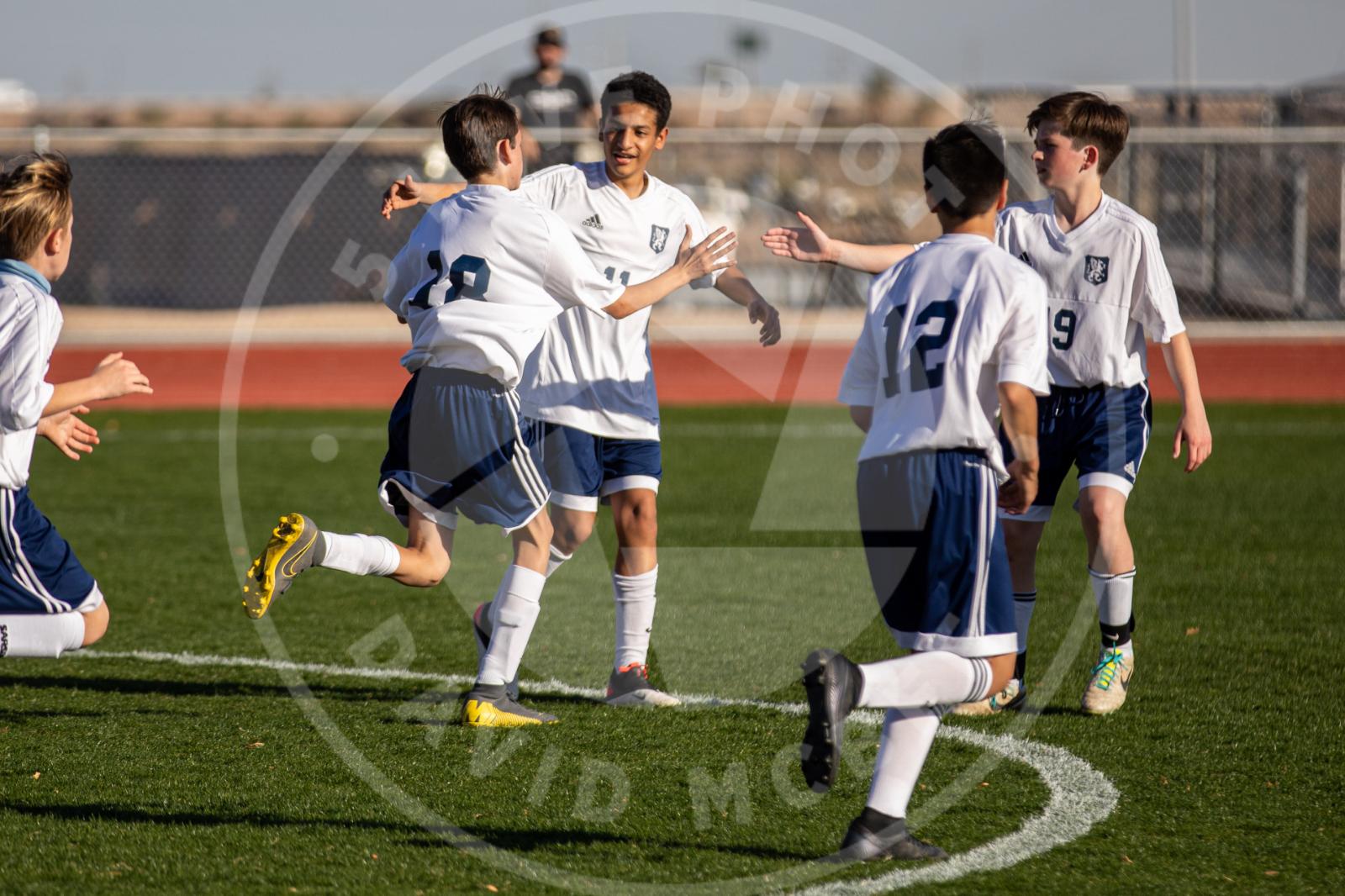 boys celebrate goal