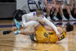 boys fight for loose ball
