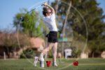 girl swinging golf club