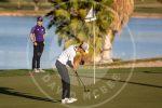 boy swinging golf club