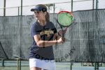 girl hitting tennis ball
