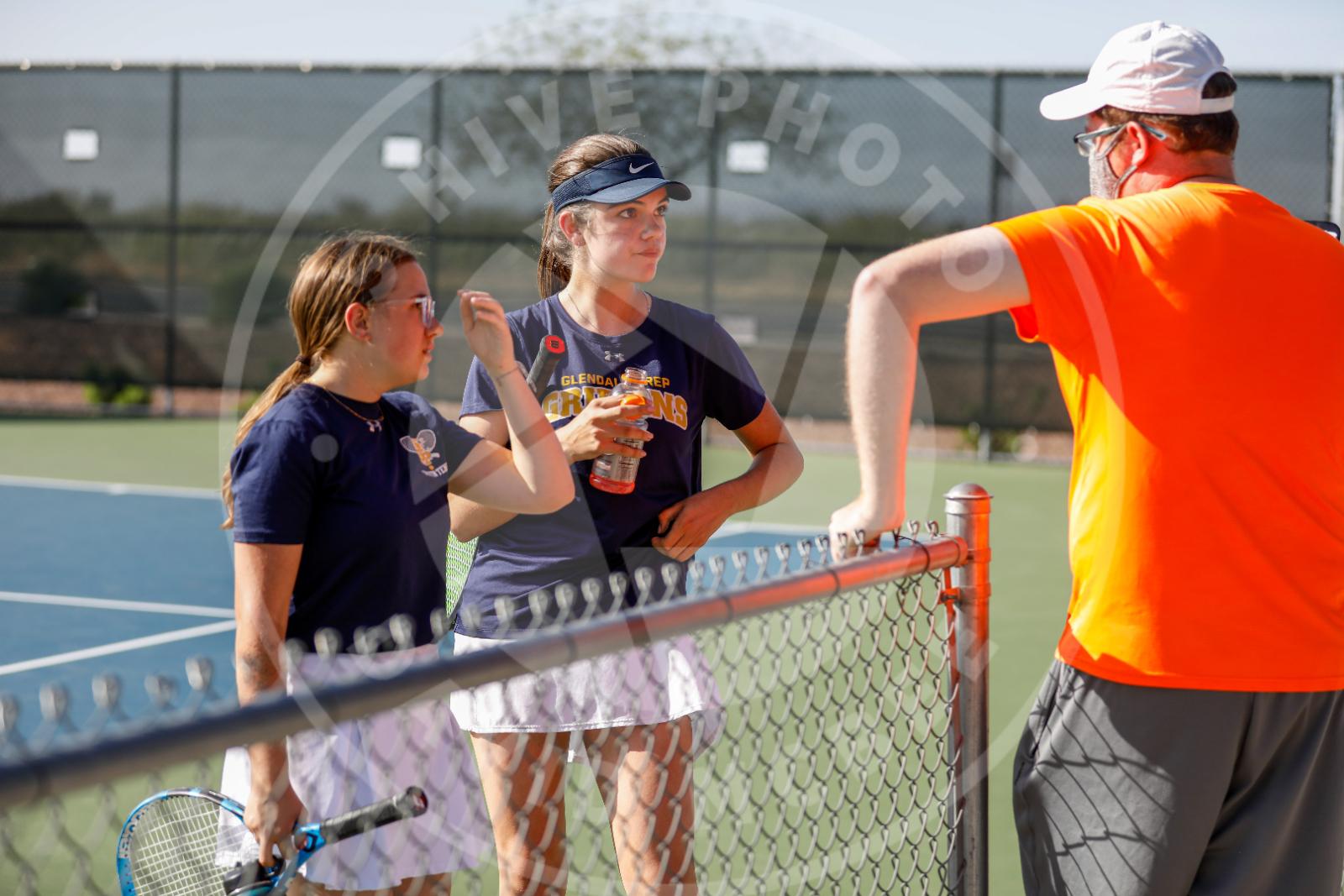 coach talks to girls