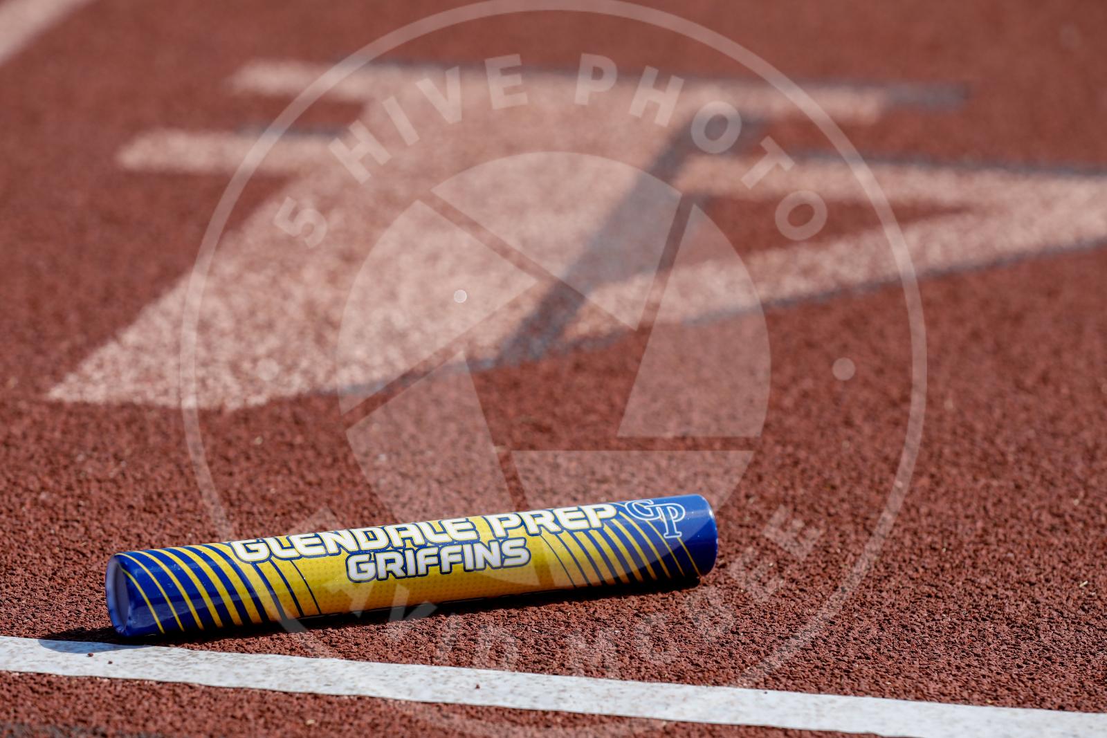 track baton on track surface artistic