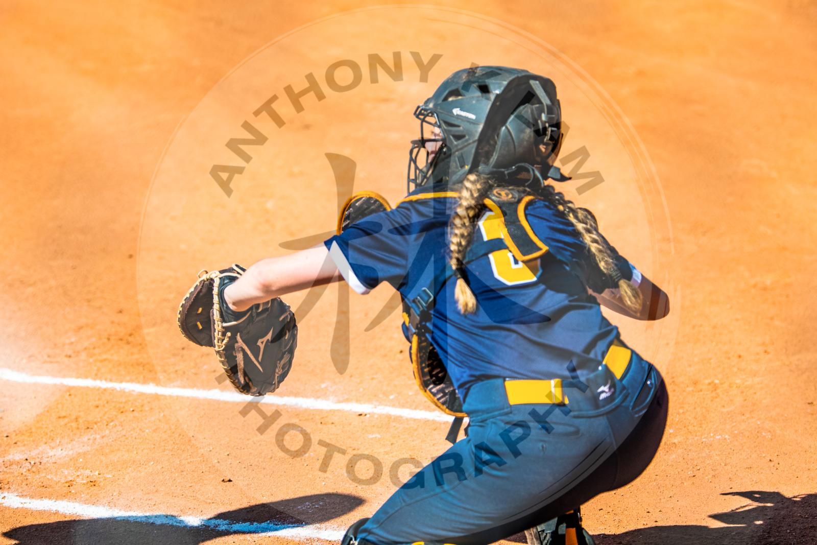 girl catching softball