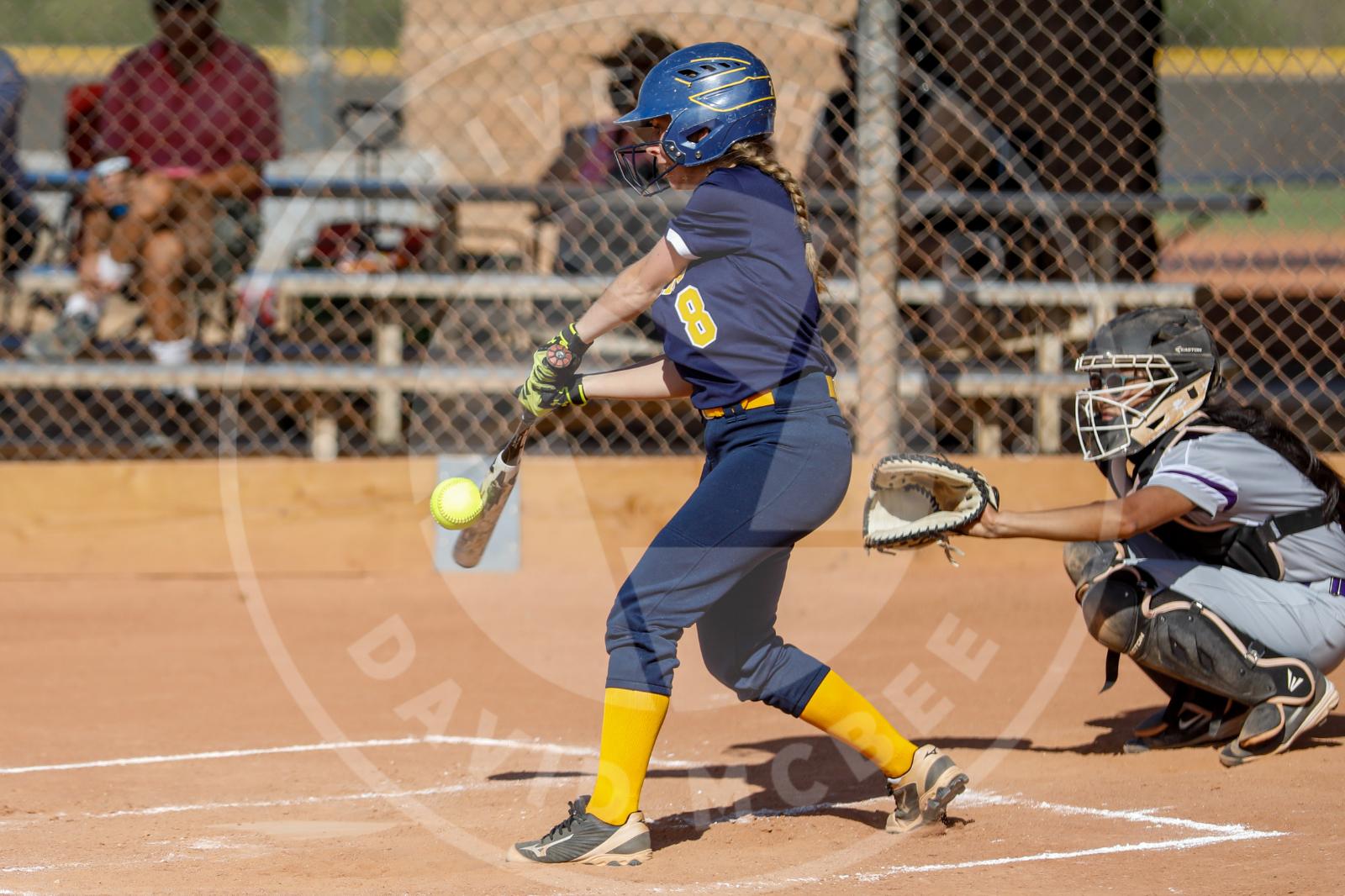 Girl batting softball