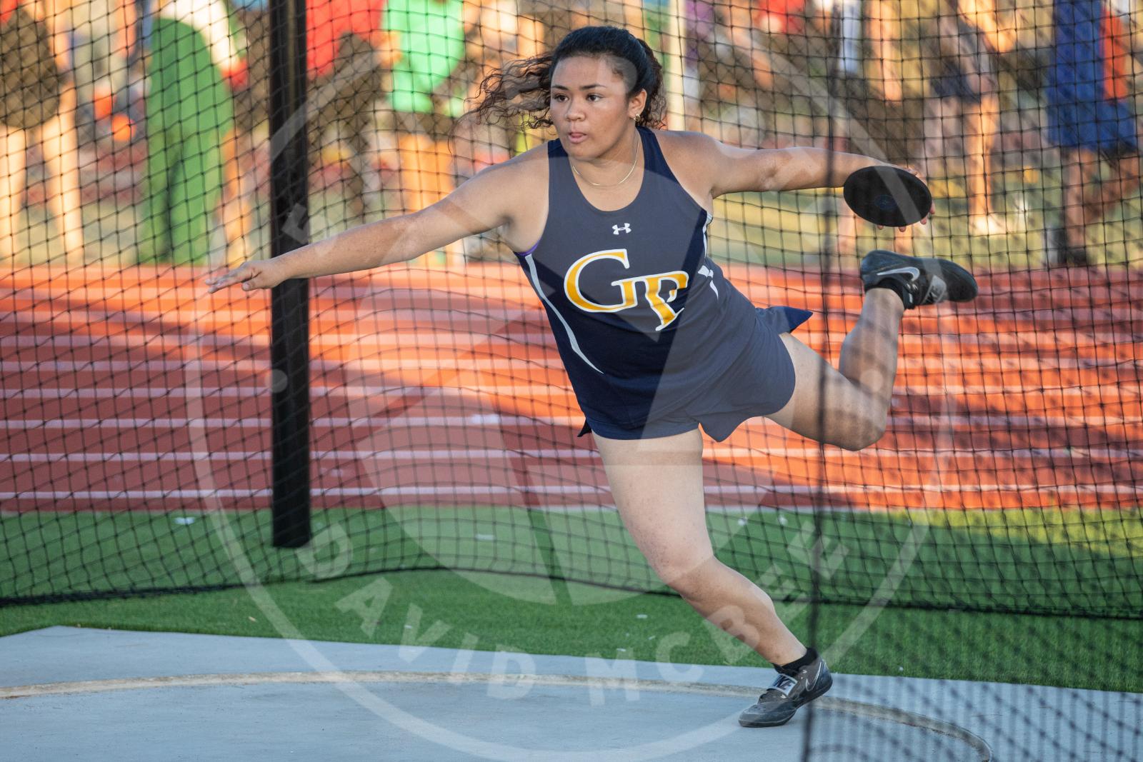 Athlete competing in discus
