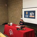 Bailey Theurer signs play at Snow College
