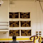 A Few of Many Banners Hanging in our Gym