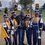 Pirate Band Director Stands Proudly with Pirate Graduates at A&T