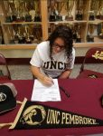 The Robesonian's Coverage of Syniah Lancaster Signing a Letter of Intent