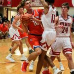 Boys Basketball: Dragons Clinch Share of Conference Title With Win Over Warriors