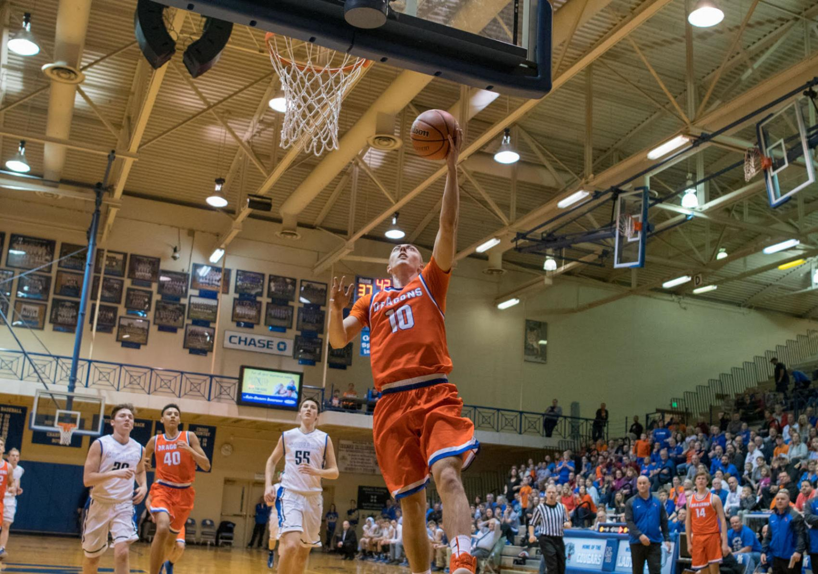 Boys Basketball: Dragons Turn Up the Heat on Cougars