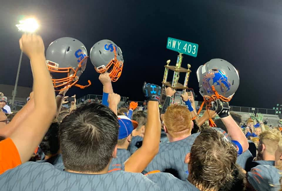 Football: Dragons Prevail 13-7 in Inaugural Battle of 403