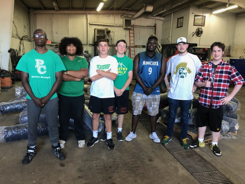 Pirate Football Players Help Young Women in Haiti