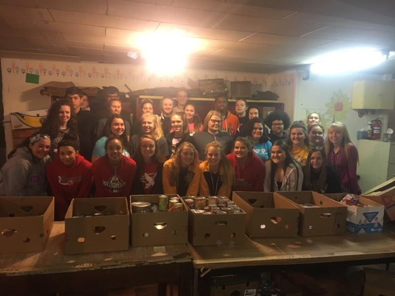 Football and Softball Combine Forces to Help Community