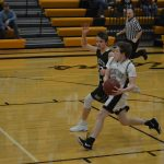 Freshman Boys Basketball Holds On for Close Victory Over Dragons