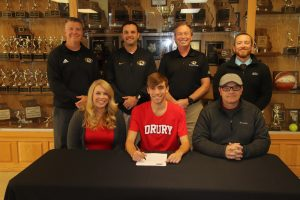 picture of Simon Ogle with his parents and coaches