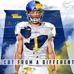 Woods commits to Michigan
