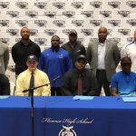 Four football players sign scholarships