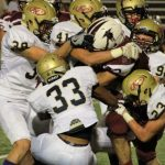 Tigers rolls into playoffs with 56-0 Victory over Northbrook