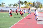 JV Boys Soccer dribbles closely