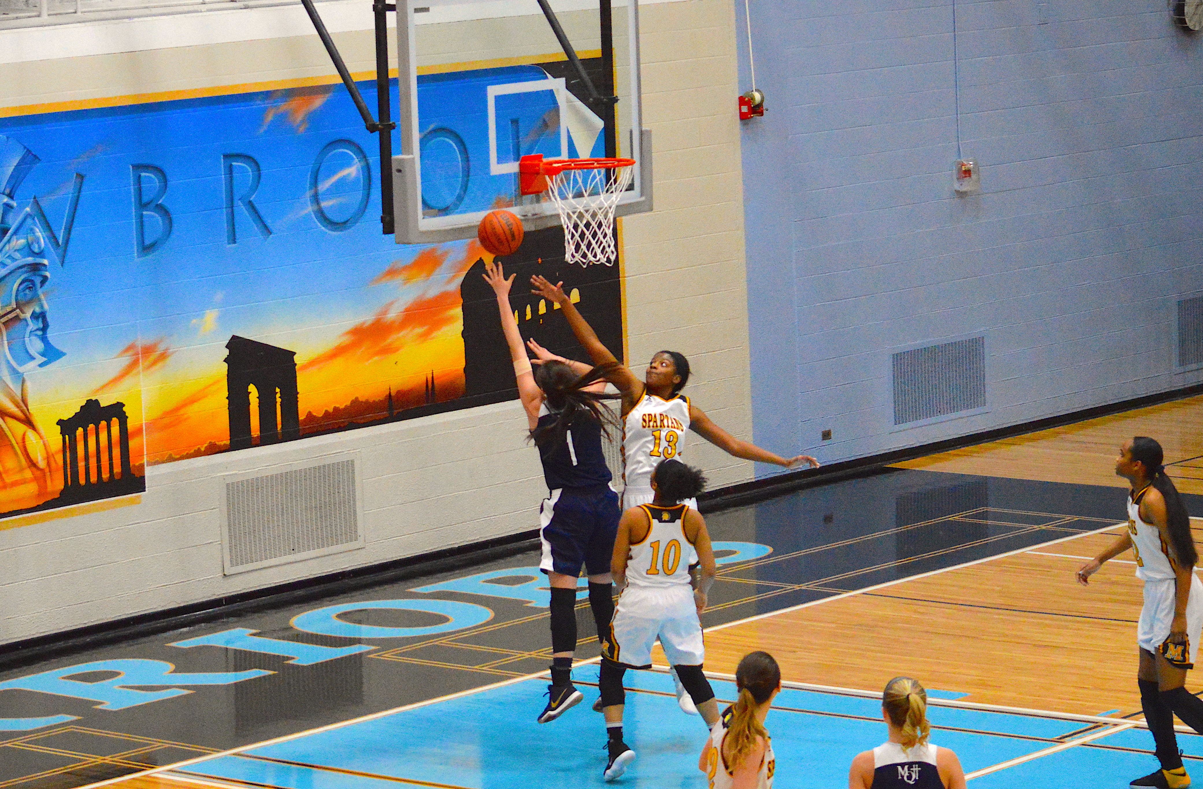 Balanced Offensive Attack Carries Marquette Past John Adams