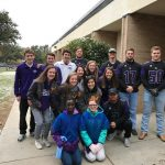 MHS Tennis and Football Players greet students at Emerson Elementary