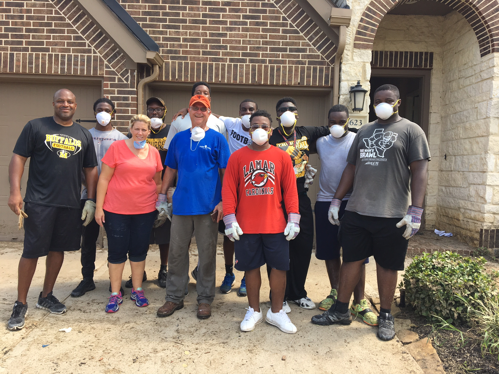 The Buffs Players and Coaches Helping In The Community