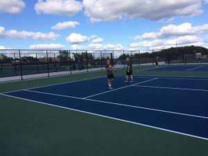Breaking in their new courts, Kenowa Hills put up a good fight but falls to Sparta 5-2