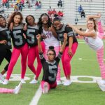 cheerleaders dance at homecoming activity