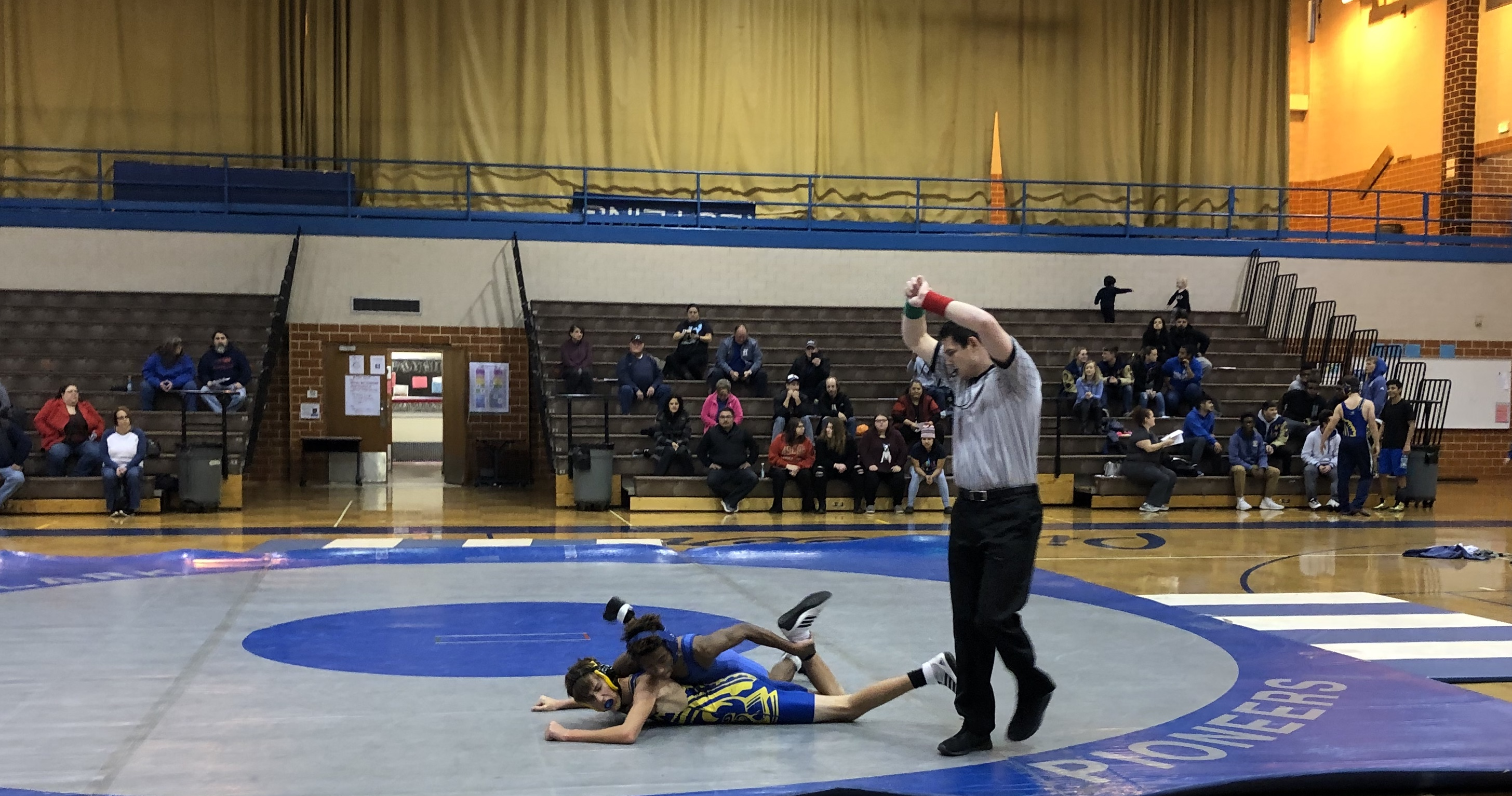 Pioneers Wrestling team defeated by Highland HS