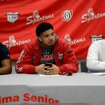 Three football players sign to schools